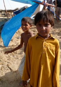 Two children outside an FH shelter in Malik Ibrahim