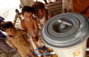 Children in Malik Ibrahim with a simple water filter in their home